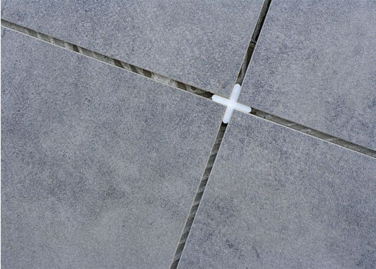 Установка крестиков на стыке 4 плиток